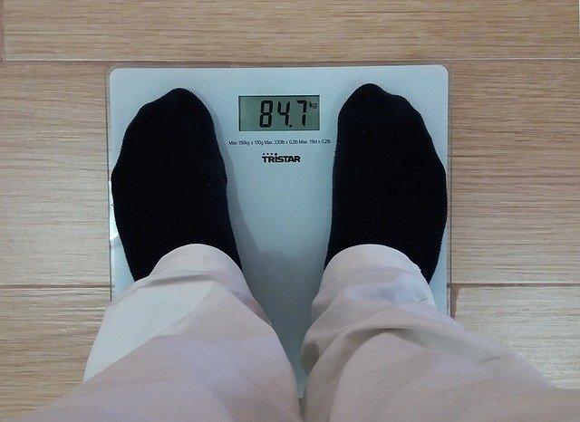 člověk na váze